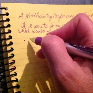 Just my hand and my purple pen as I write in my spiral-bound notebook